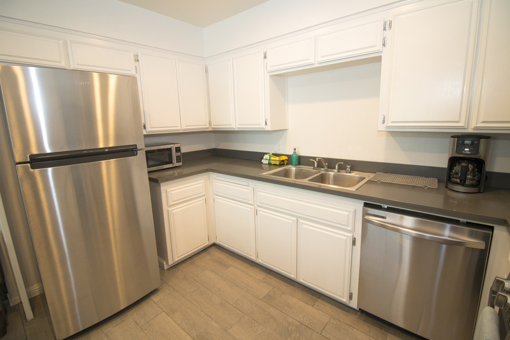 You'll find a full sized fridge in our fully equipped Two Bedroom Kitchen Suite.